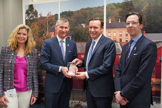 Senator Chris Murphy receives award with Jane Hunter, David Costello and Frank Montie